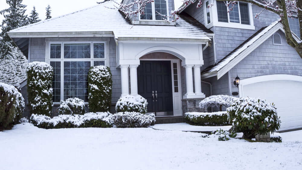 Do You Have Cold Weather Damage to Your Sprinkler System - House in Snow